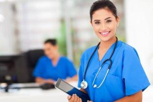 Vocational nurse holding a medical folder